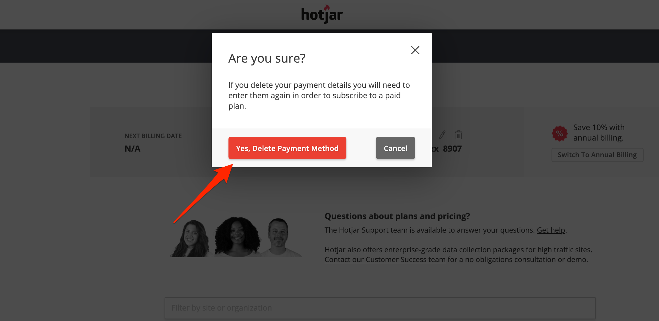 Alert box with a red arrow pointing to a red button with the words delete my payment method.
